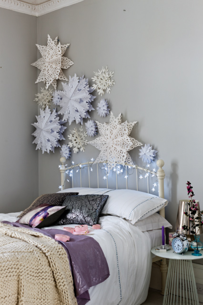 Fancy Paper Snowflakes Attached To A Bedroom Wall